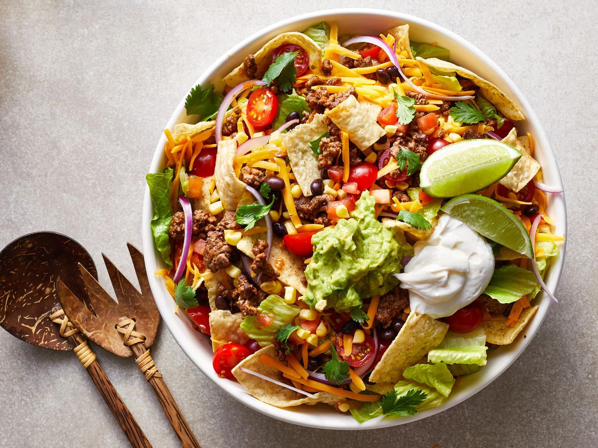 Perfect for hectic weeknights, this easy taco salad recipe is something both kids and adults will love. The beauty of taco salad is that it's entirely customizable to your favorite taco components, so feel free to stray from the recipe to accommodate whatever you're craving and/or the ingredients you already have on hand. For example, you can easily swap in some diced avocado for the prepared guacamole. Pro-tip: Allowing the ground beef to sear before crumbling helps it to brown nicely without #tacosalad