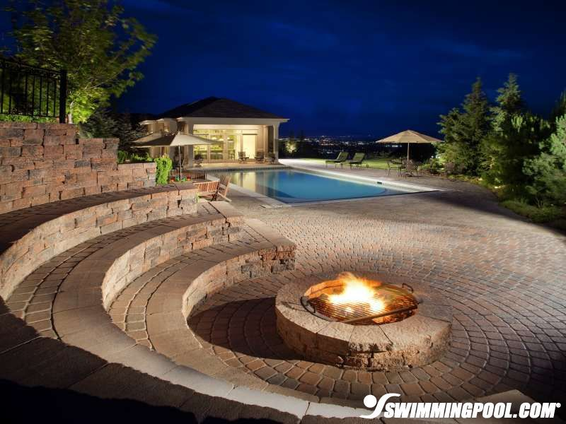 Fire pit around swimming pool the great outdoors pinterest fire for Fire features for swimming pools