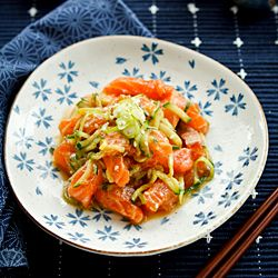 Marinated salmon sashimi salad using miso, soy sauce and other condiments.