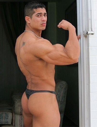 Muscle men in thong something is