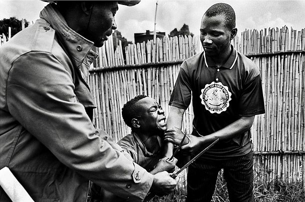 Congos Child Soldiers  Photo Essays  Current Events Bad  A Child Soldier Is Stripped Of His Knives For Many Of The Children Soldiers  Demobilization Represents A Loss Of Status And Identity