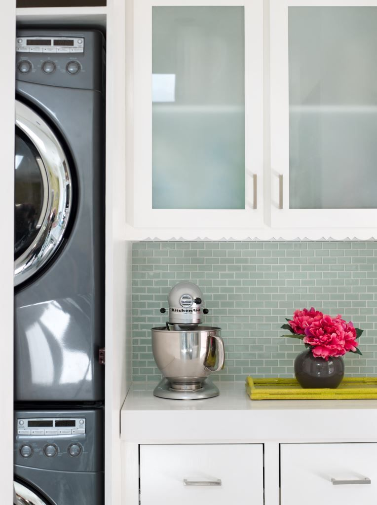 A Stackable Washer And Dryer Consolidates Room Laundry