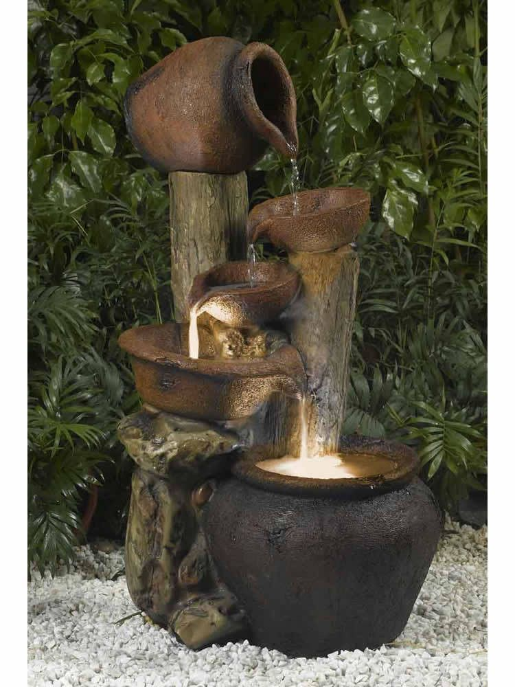As One Tipped Pot Pours Into Bowl Below The Process Of Water Dancing Begins In Jug And Tiered Fountain Lights Illuminate Largest At
