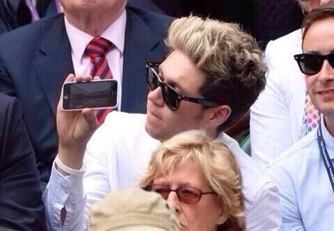 Niall with technology! look at him filming with his front camera!
