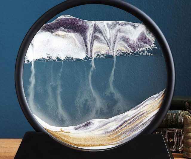 Gain a deeper appreciation for science by learning about the universal principle of entropy with this deep sea sand art sculpture. Each time you rotate the glass ring, the different colored sands begin shifting to create deserts, mountains, clouds, rain, oceans and smoke.
