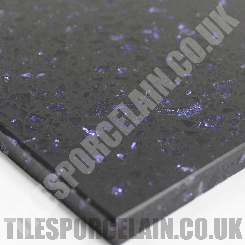 cosmos black quartz tiles with sparkly blue mirror flecks. the