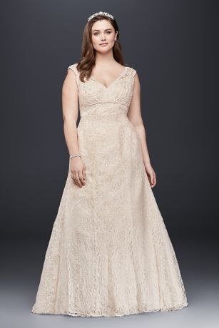 3ab8b9c23784 This gorgeous plus-size trumpet wedding gown, elegantly crafted with beaded  lace, features a deep V-neckline, low back, illusion cap sleeves and a ...