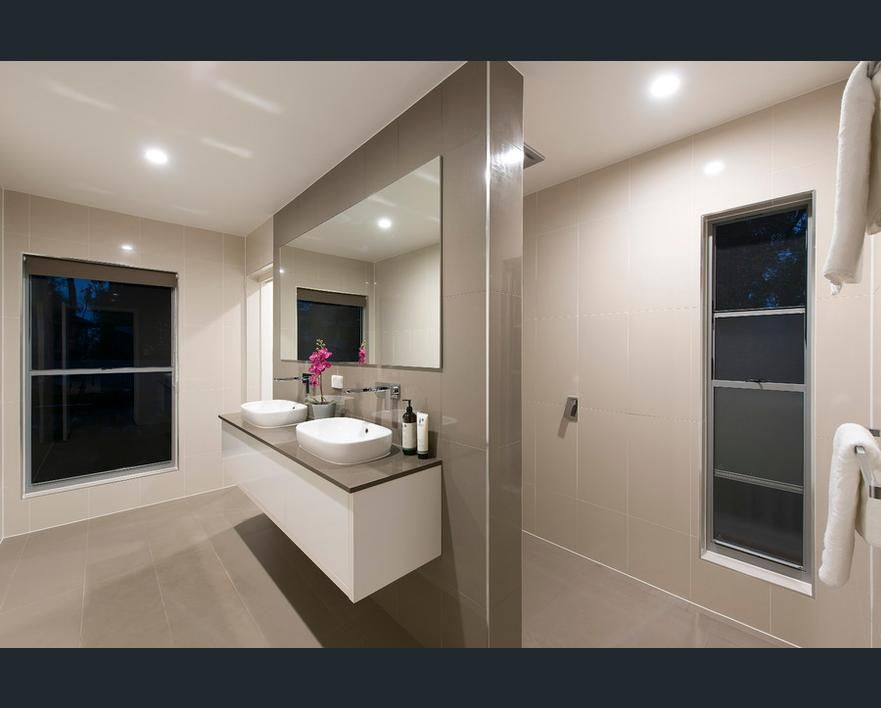 Bathroom Tiles Queensland modern ensuite with double vanities and floor to ceiling tiles in
