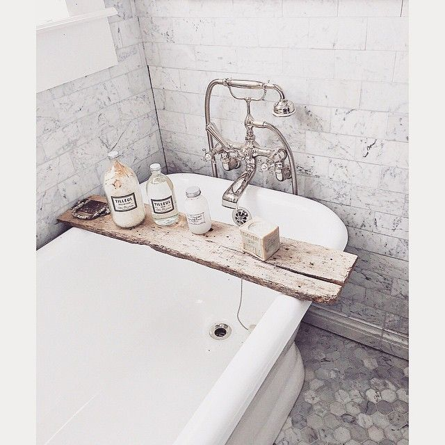 """We left the original vintage French barn door hardware on the boards.  Tub is from @vintagebath_losaltos faucet from @rohlfaucets and French bath and body…"""