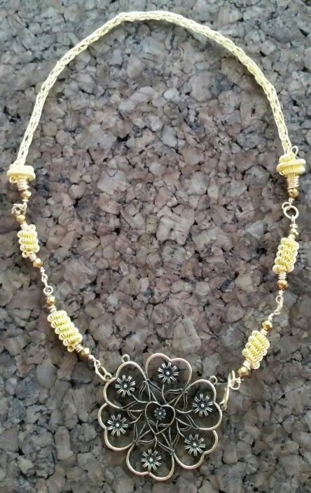 Gold colored viking knit fairytale necklace!