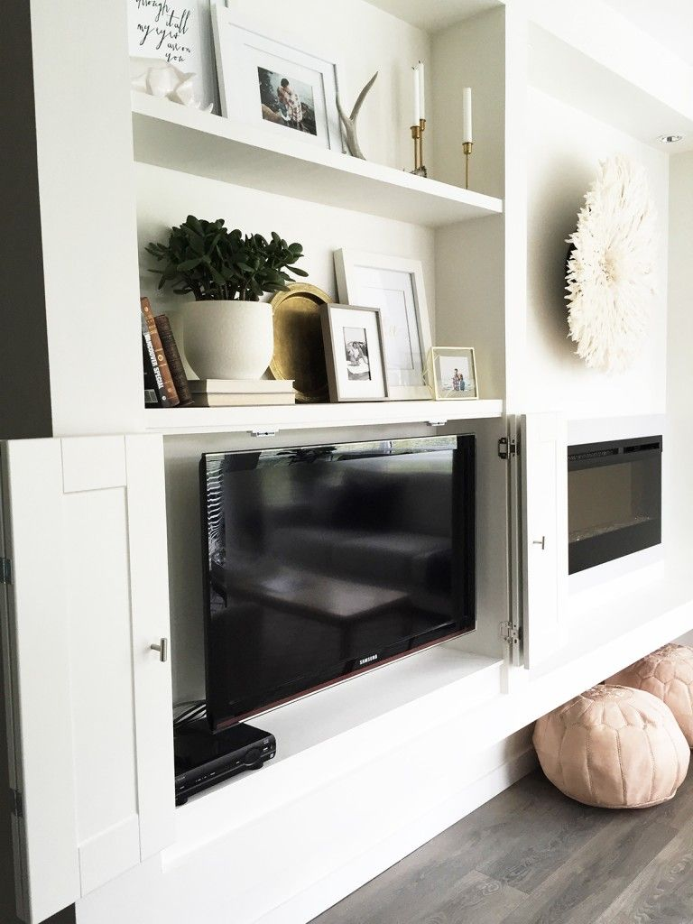 Built Ins To Hide Your Tv In Everything Built In Shelves Living Room Family Room Design Fireplace Built Ins