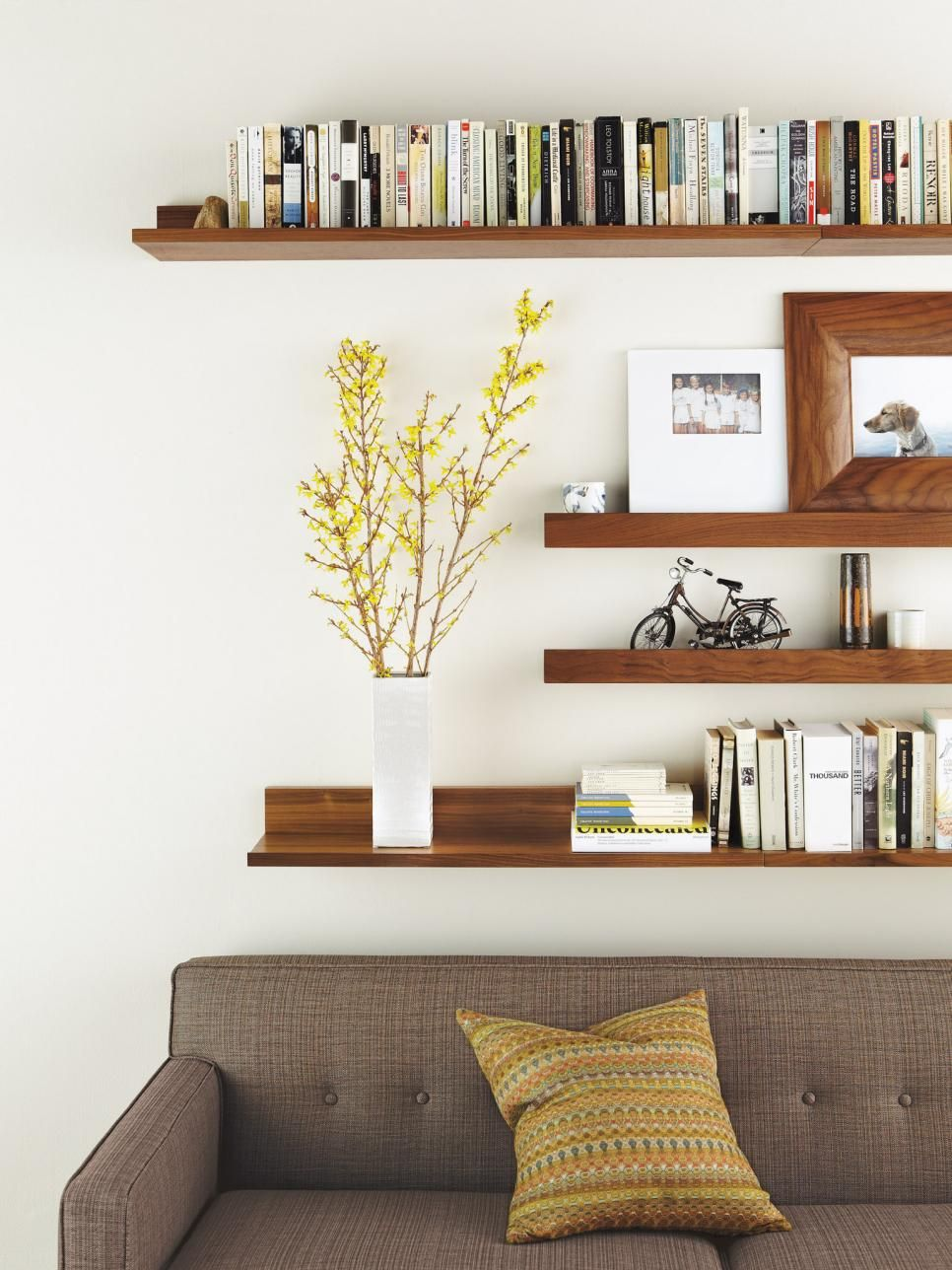 Modern Living Room With Wall Mounted Shelves Floating Shelves Living Room Bookshelves In Living Room Wall Shelves Living Room