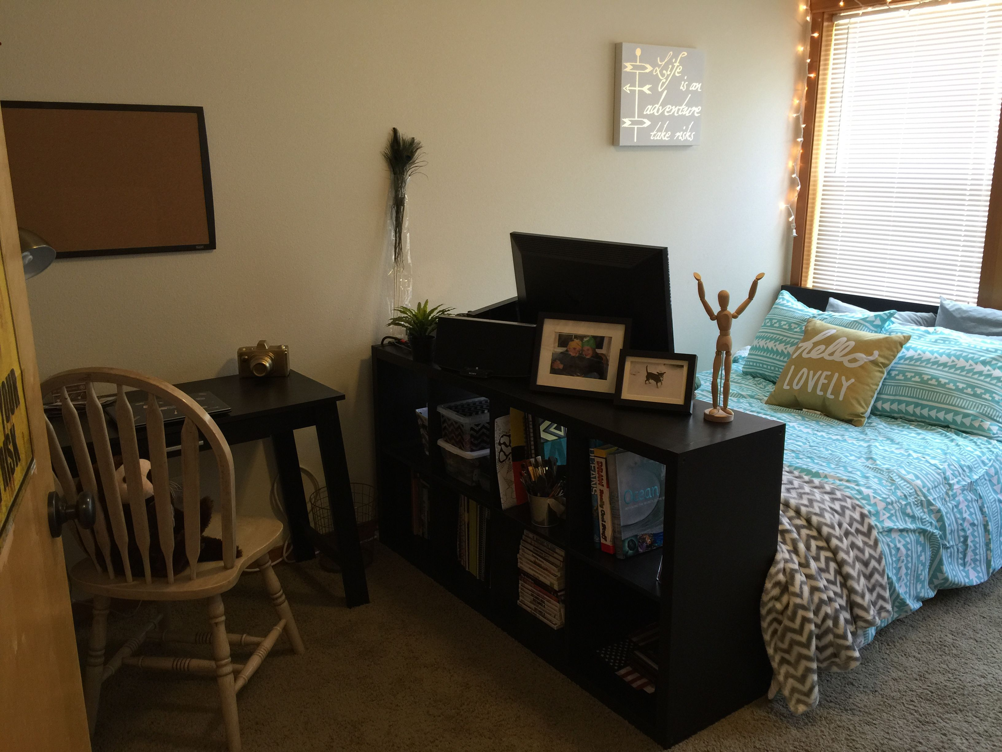 For my daughters 16th birthday, I redecorated her whole room as a surprise! (To really appreciate you would have to see the before pics). I used string lights, canvas', her colors are Aqua, gray & gold, chevrons & Aztec bedding