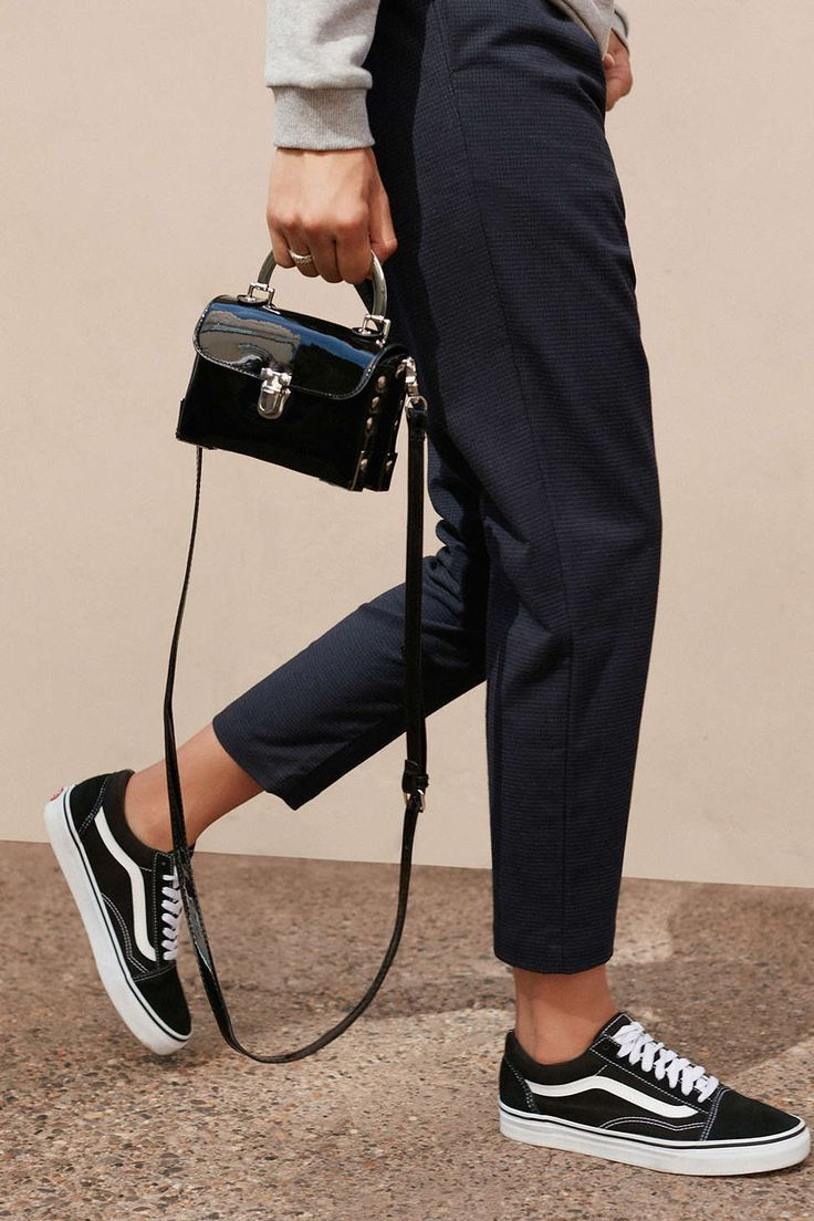 mini patent bag, cropped navy pants, and classic Vans sneakers
