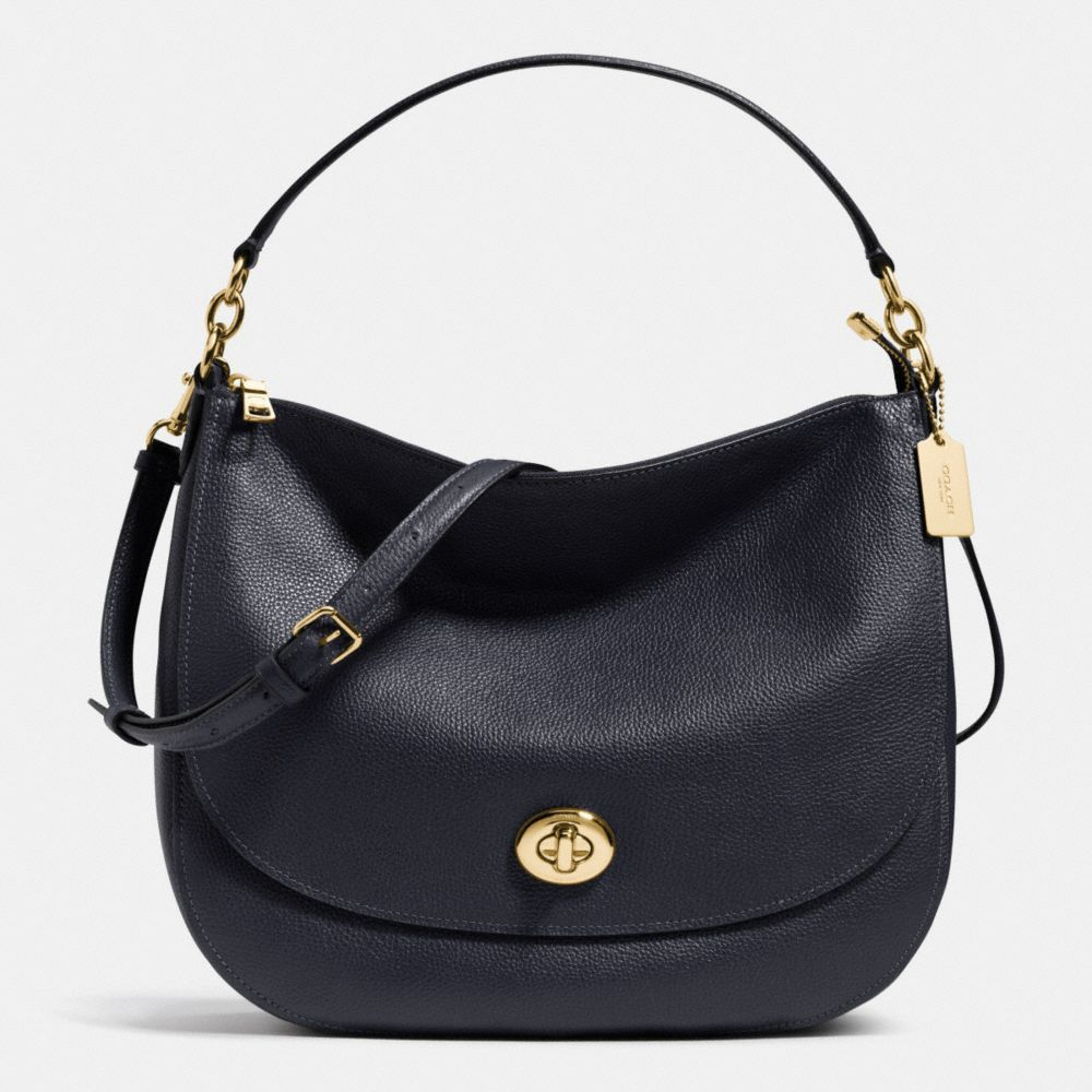 The new and versatile Turnlock Hobo in plump pebble leather has a soft hand  and a luxe sheen. Its spacious silhouette comes finished with an  easy-access ... 84d8bdb3bf