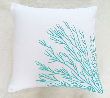 white throw pillow with aqua blue coral trellis embroidery