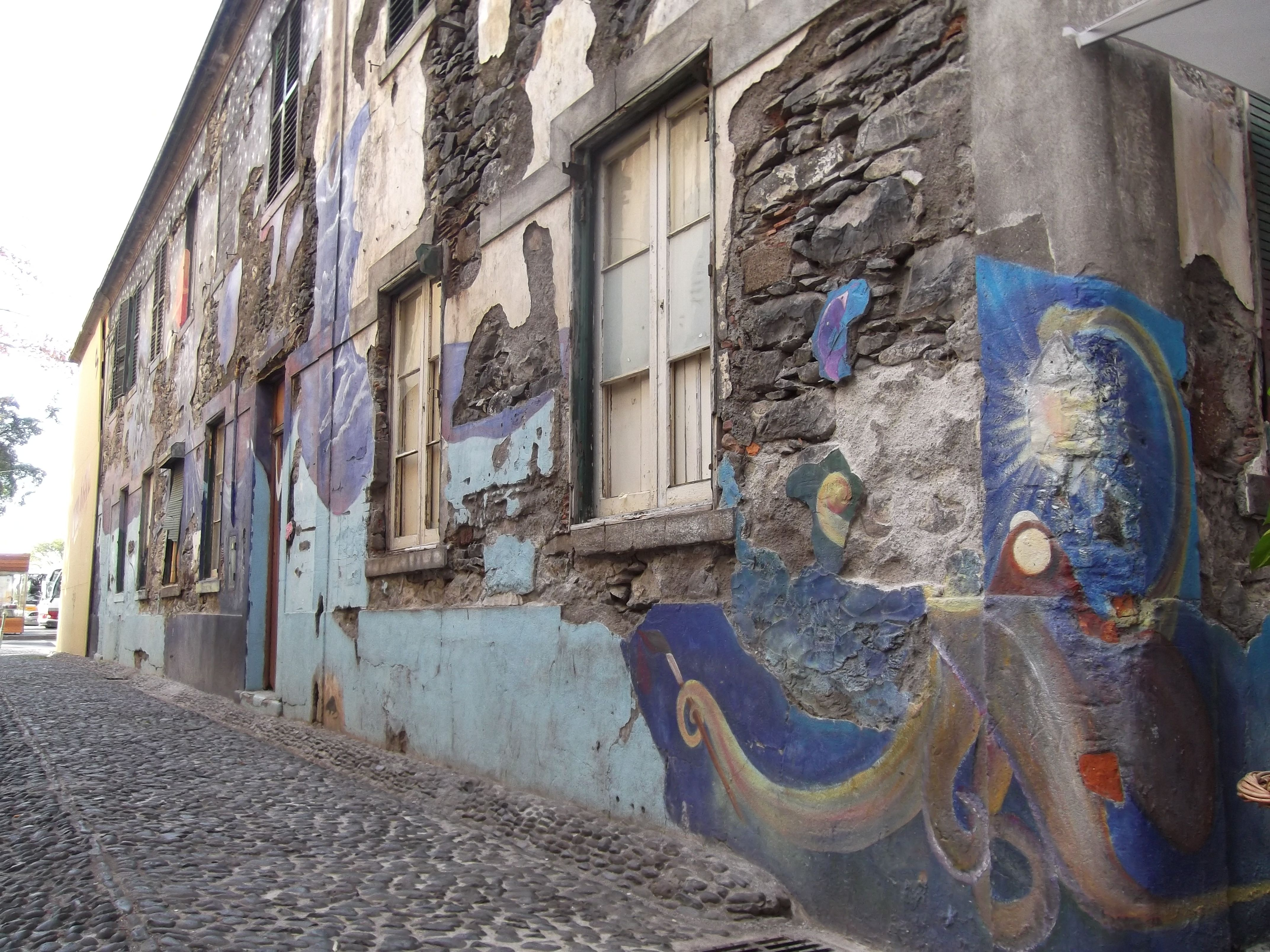 Old Town, Funchal, Madeira. Why mend a wall when you can decorate it?