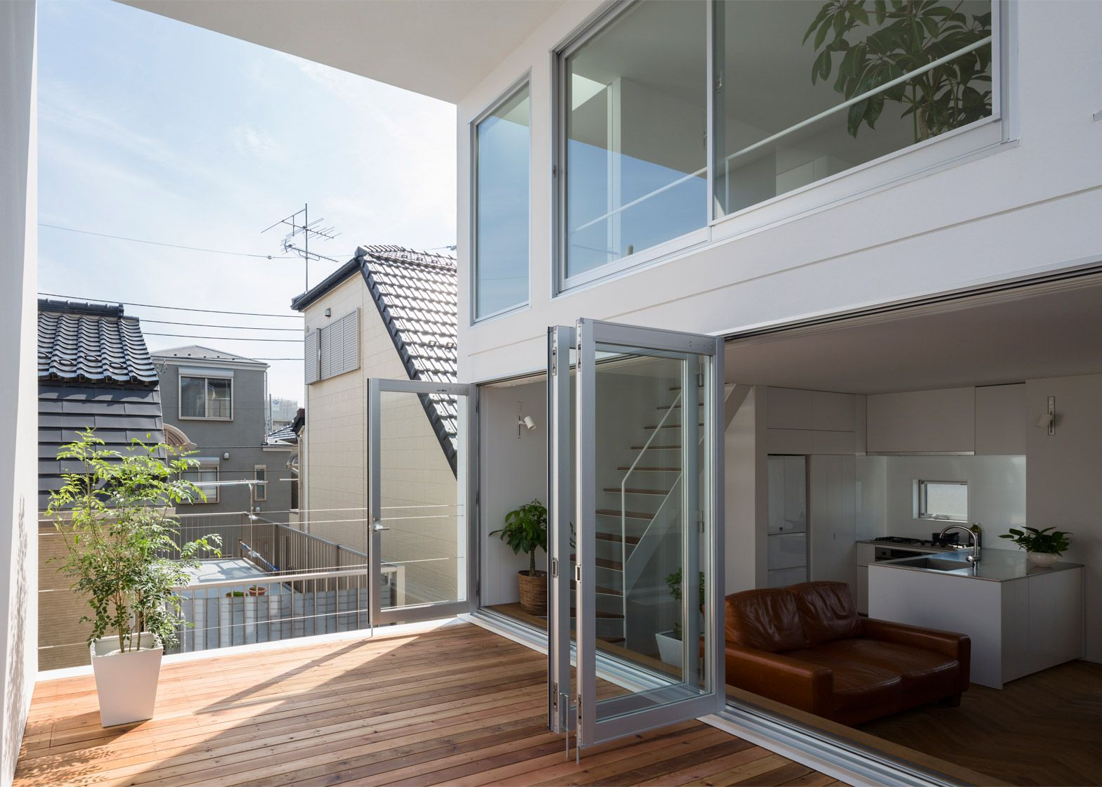 this white house in tokyo by takuro yamamoto architects features an elevated yoga terrace. Black Bedroom Furniture Sets. Home Design Ideas