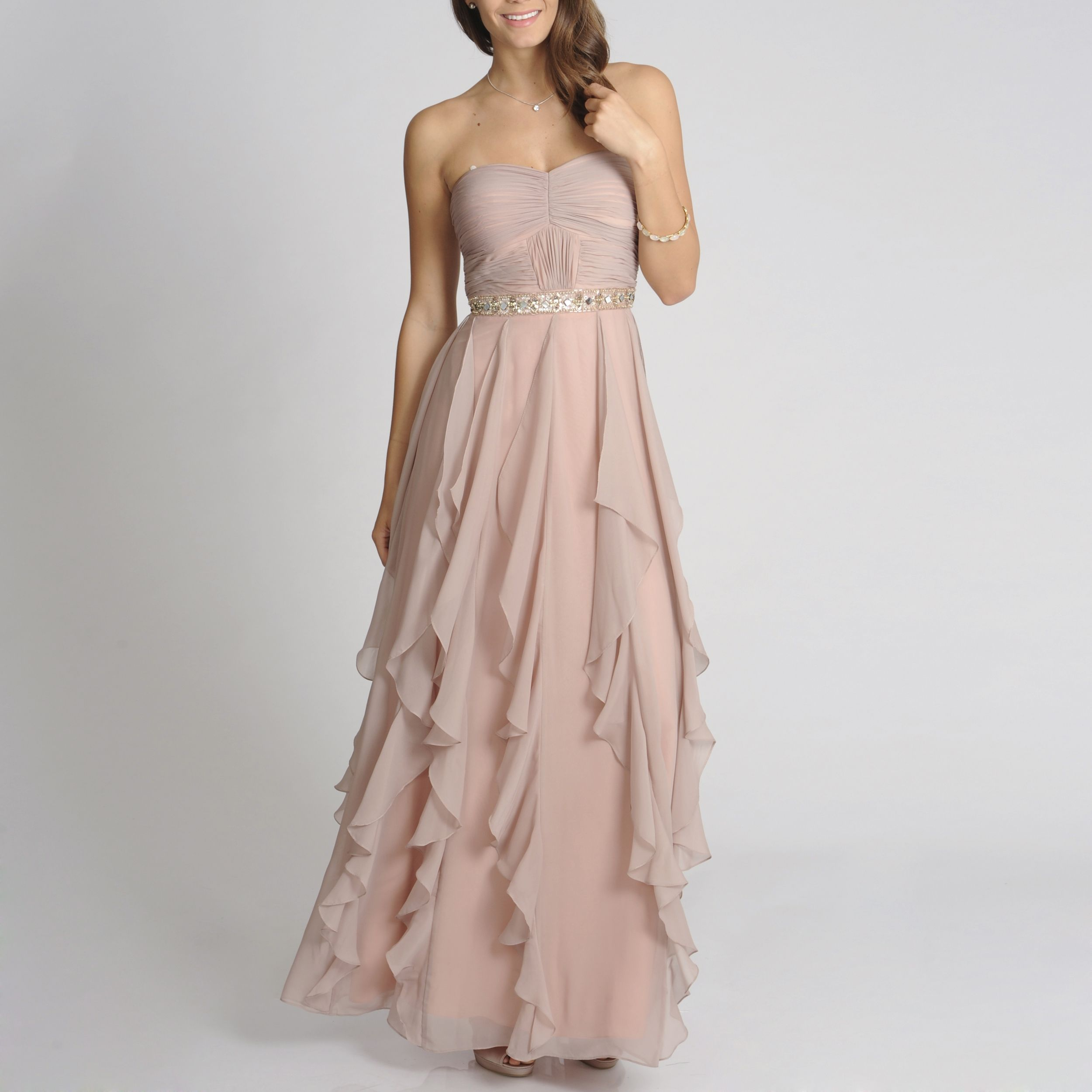 Be the belle of the ball in this gorgeous long, flowing evening gown. Featuring a beautifully tiered skirt that falls in the most graceful way and a soft, inviting hue, this lovely dress can be paired with jewels of any color for a sophisticated look.