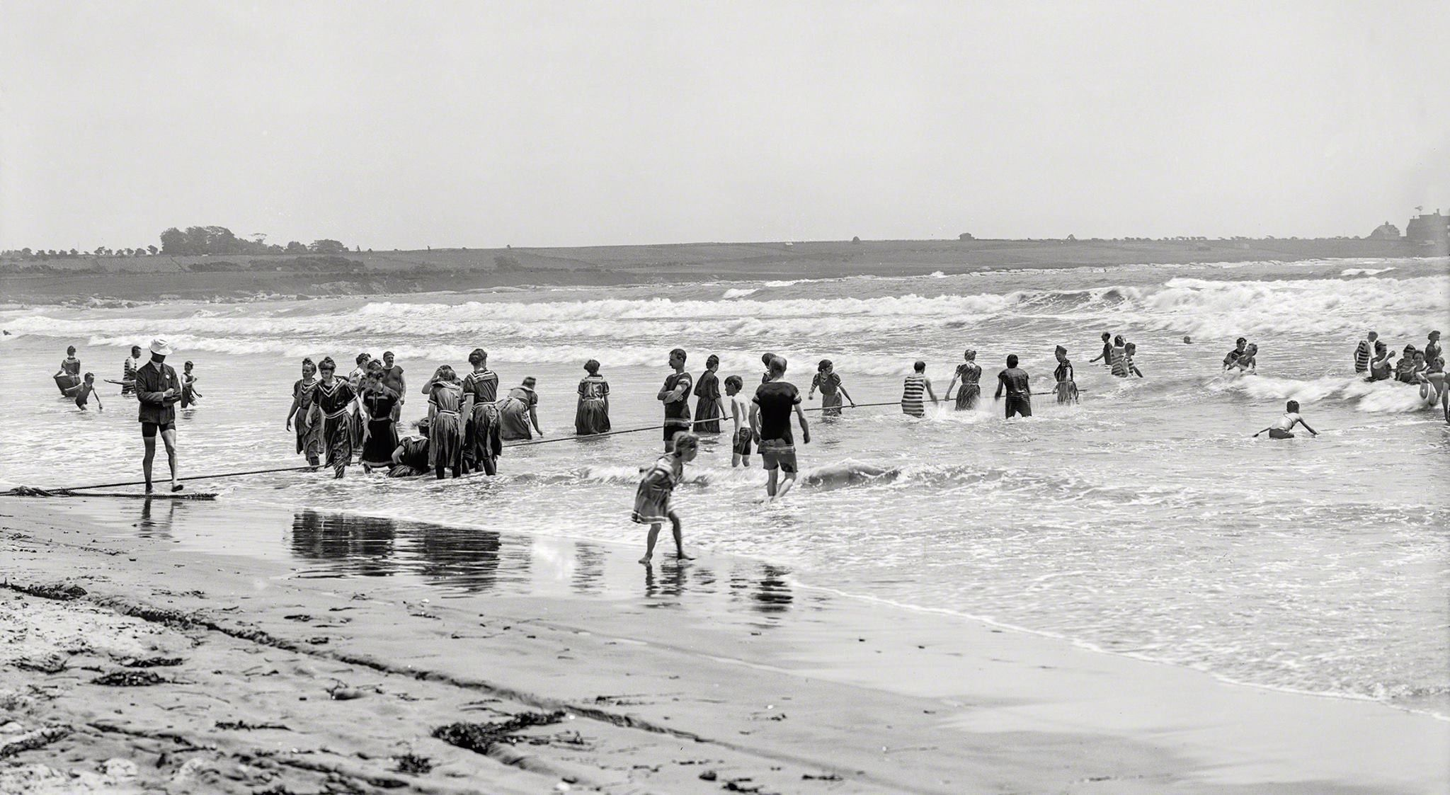 Busy bathers gather in the surf at Easton's Beach, Rhode Island, USA. Circa 1904.