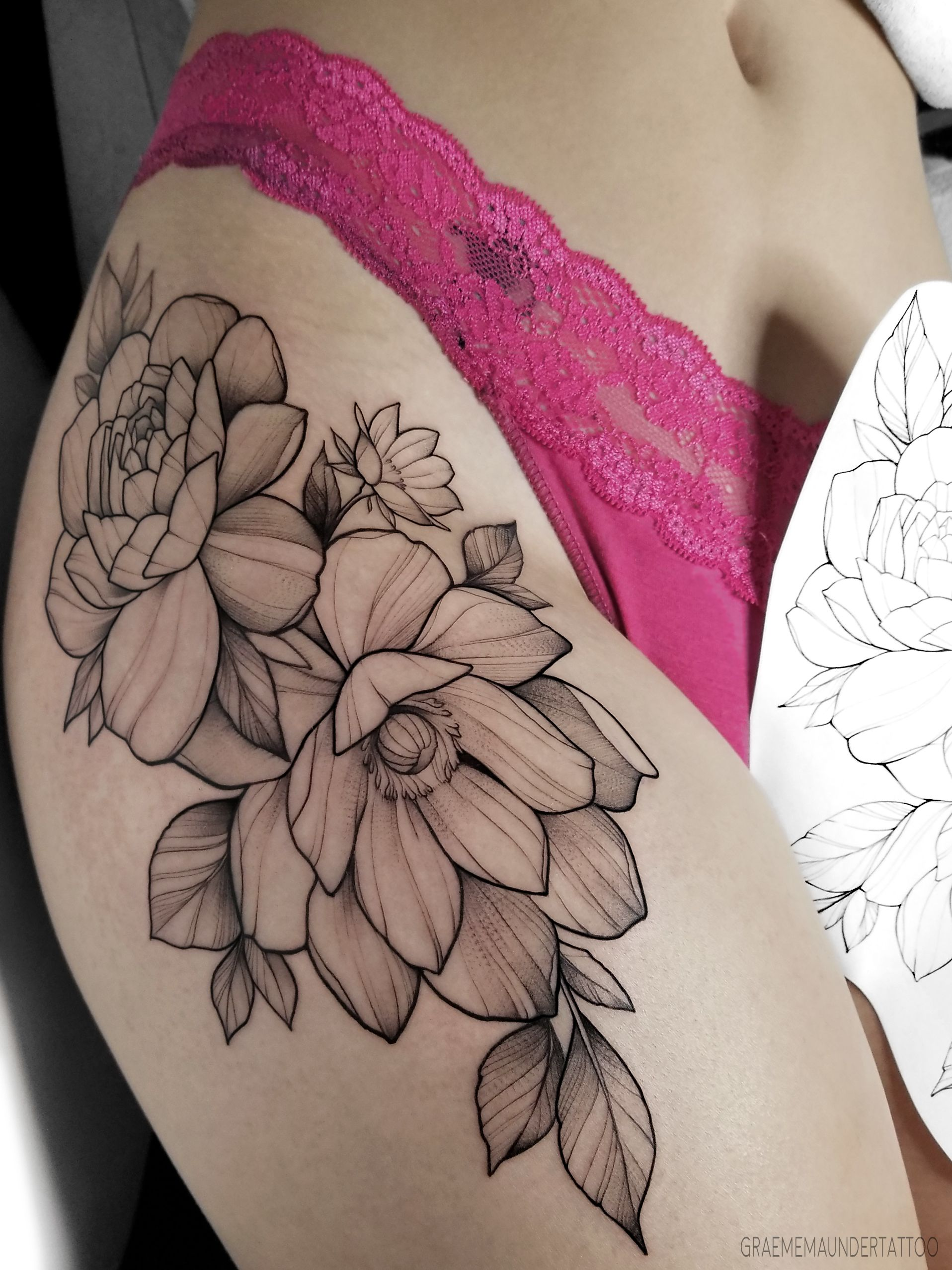 Mixed floral thigh tattoo