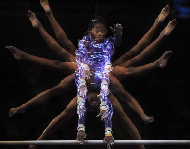 Gymnast Gabrielle Douglas competes in the uneven parallel bars at the AT American Cup on March 3, 2012 at Madison Square Garden in Manhattan, New York.