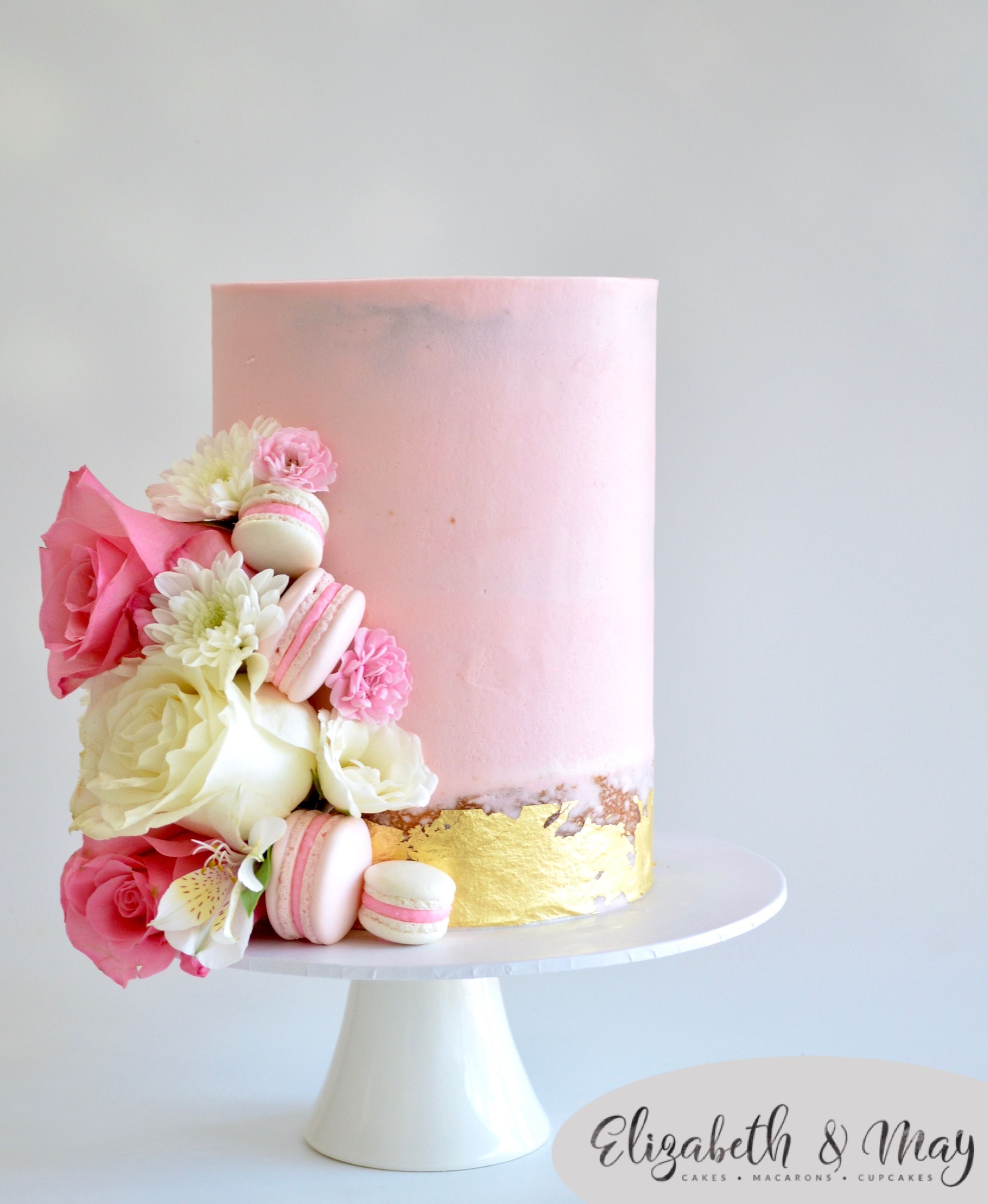 Pink Semi Naked Cake With Gold Leaf Macarons And Pink And White