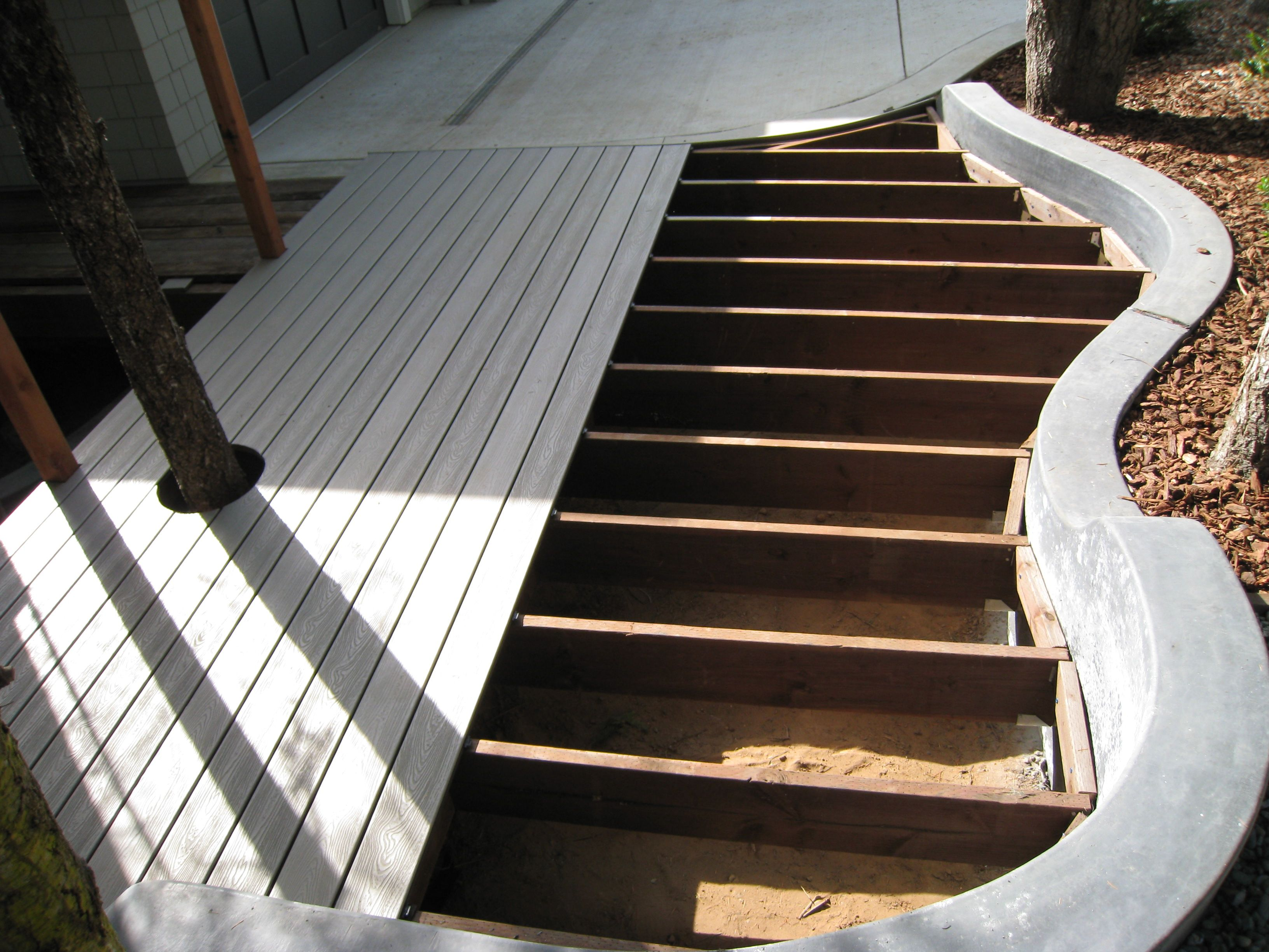 Colored concrete retaining wall with deck. | decks ...