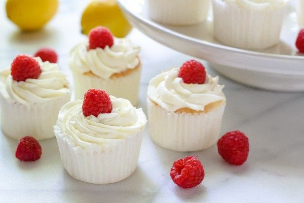 Lemon Angel Food Cupcakes filled with raspberries and topped with whipped lemon cream