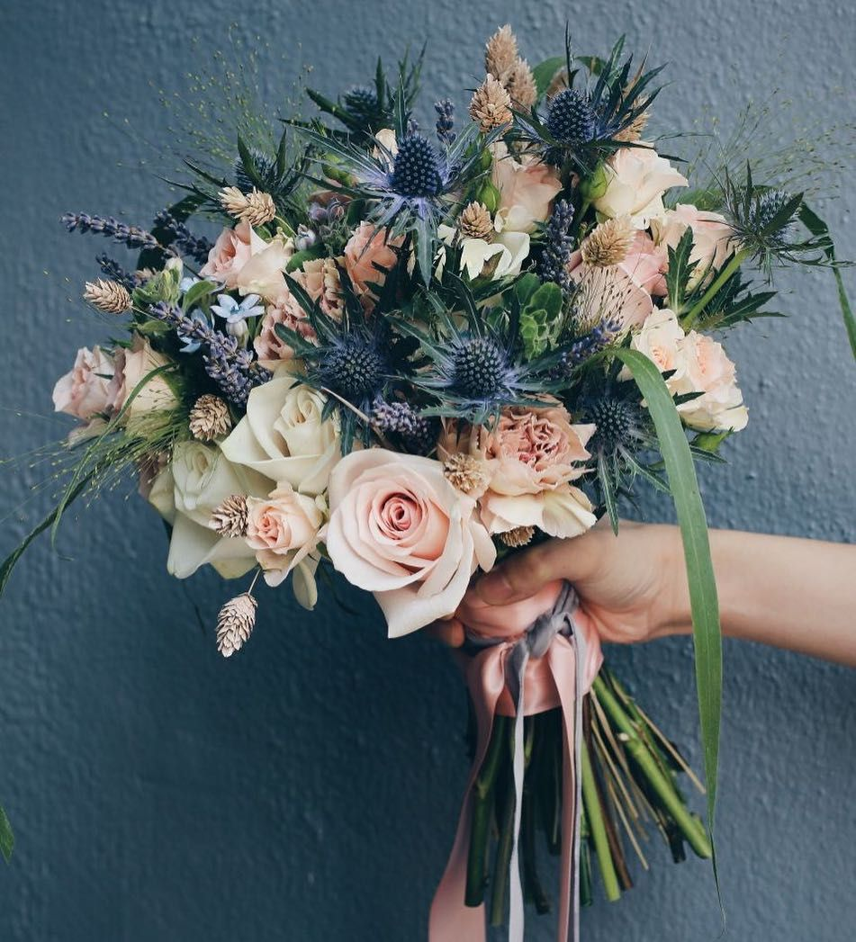 Wild lavender, wheat, thistle and fountain grass give this bridal bouquet a bit of spunk and playfulness! #dawnqweddings #dawnqfloraldesign…
