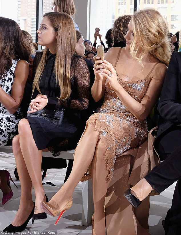 Getting inspiration? Blake took photos of the designs on her cameraphone as she watched th...