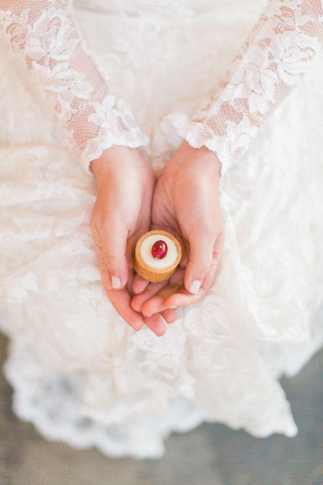 Long sleeve wedding dress + a cherry bakewell tart place setting/favor | Sam Kirk Photography | Bridal Musings Wedding Blog