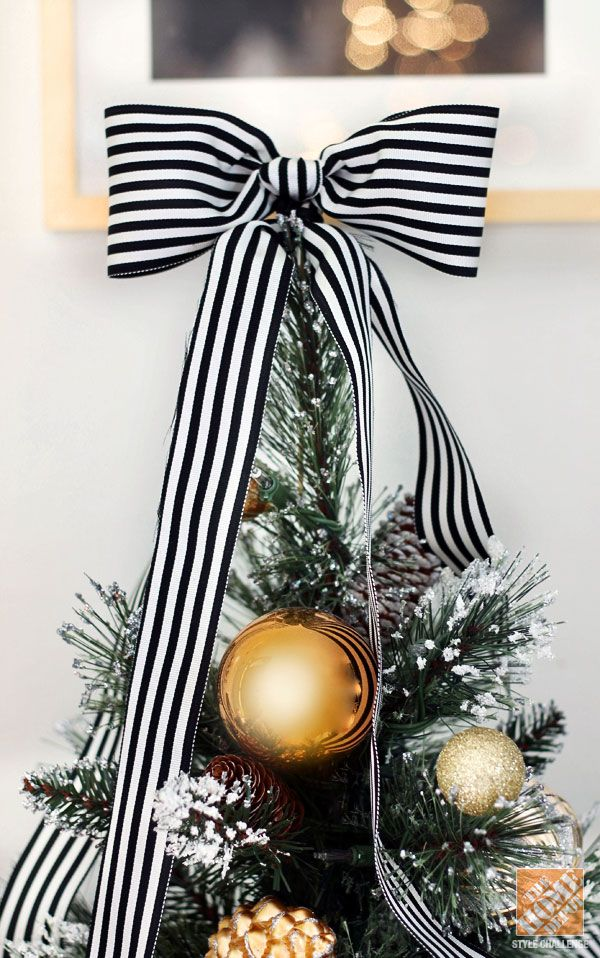 Christmas Decorating Ideas Tree Topped With Black And White Striped Bow Treetopper