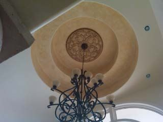The trayed ceiling in the entry way of this house was built for the Fleur and Vine Medallion.