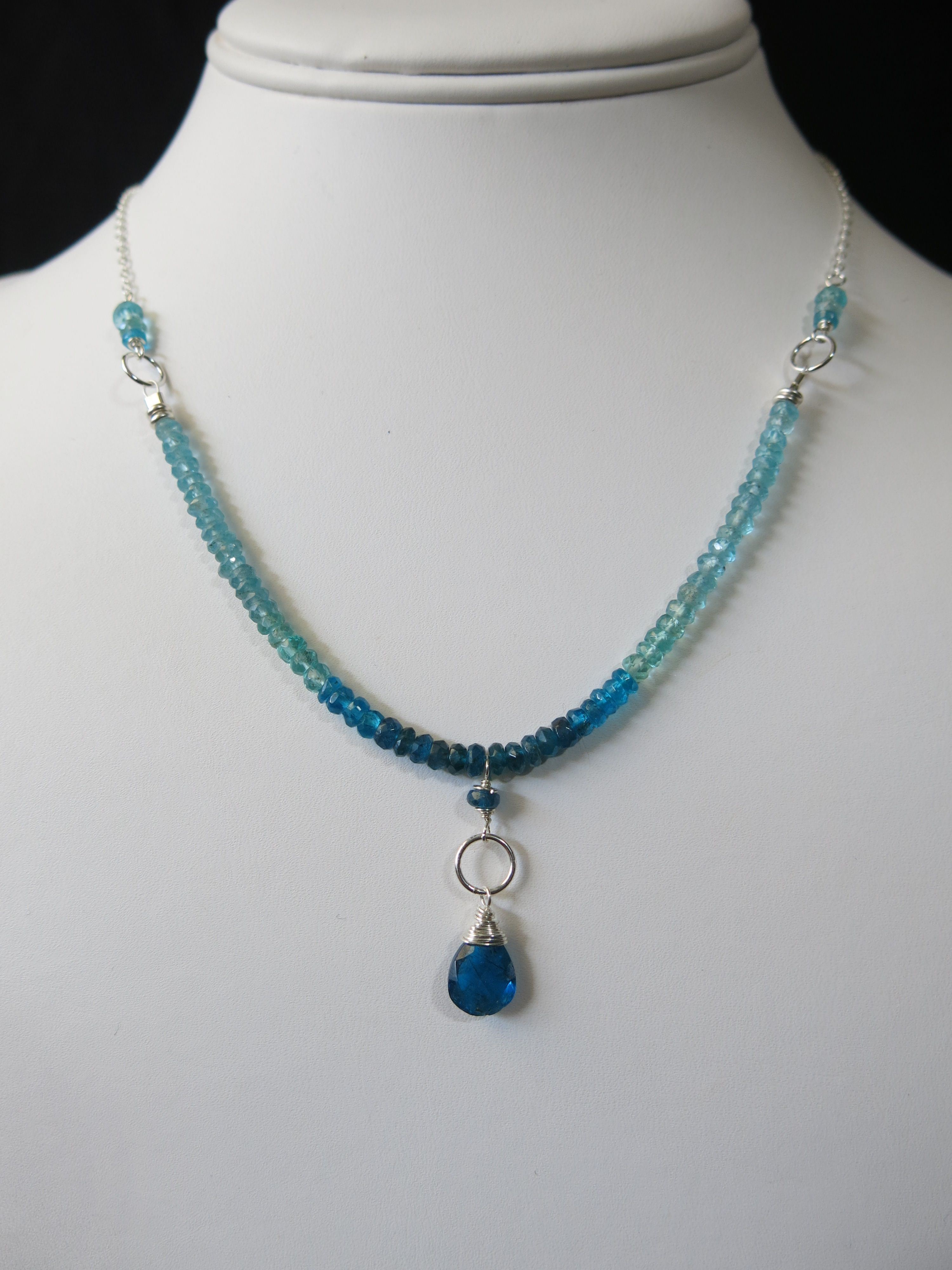 Blue Apatite Necklace.  Bright Blue Apatite briolette wrapped in sterling silver surrounded by different shades of blue Apatite www.sarahwalkerjewelry.com