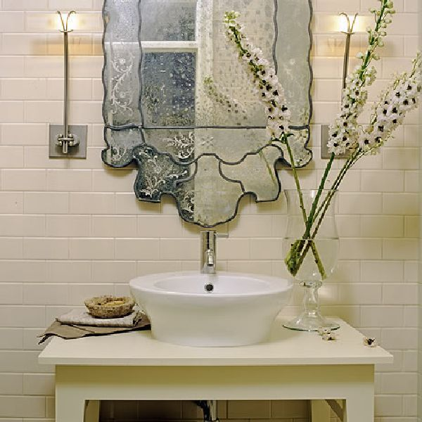 unique mirror adds character and charm to this vanity space