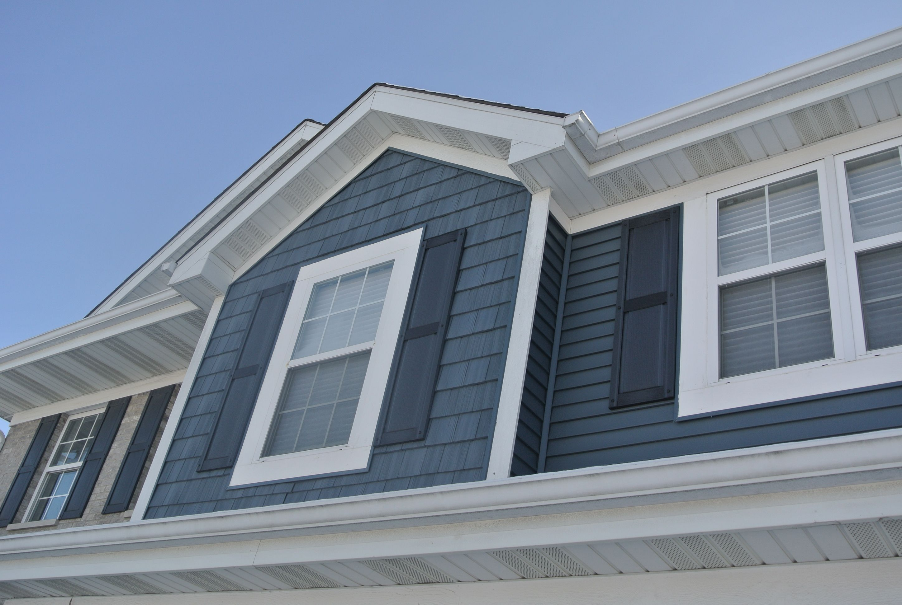 7 Popular Siding Materials To Consider: Pacific Blue Vinyl Siding By CertainTeed. This Shows The