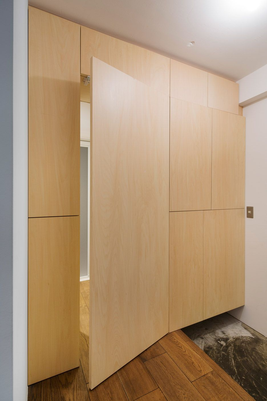 A Second Wall Of Sliding Door Panels Are Used To Cover Both Kitchen And Living Room Storage Sliding Door Panels Hidden Doors In Walls Hidden Door