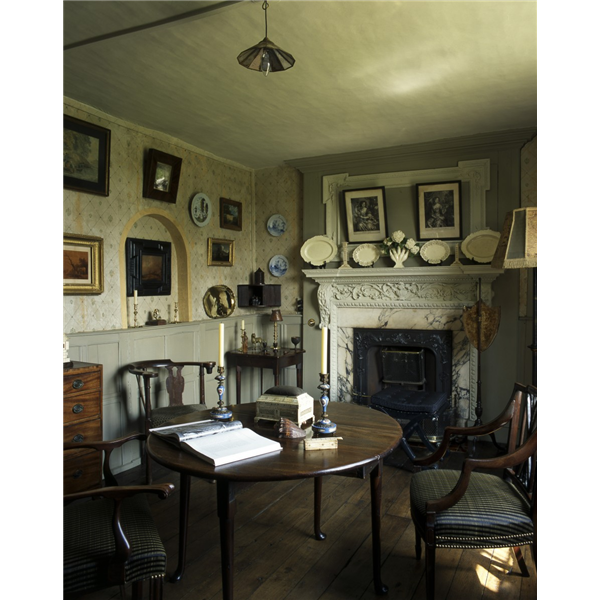 Restoration House, Rochester, Kent. A small back parlour on the raised ground floor known as The Eccentric Room.