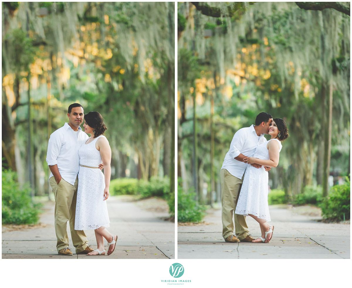 Walking alongside street underneath spanish moss filled oak trees in Forsyth Park  #forsythpark #georgia #love #ido #engagement #savannah