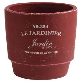 "Display vibrant blossoms or lush greenery in this charming ceramic pot, showcasing a French script motif and a weathered finish.   Product: PotConstruction Material: ClayColor: RedFeatures:  French script motifHandmadeWeathered finish  Dimensions: 8"" H x 8"" Diameter"