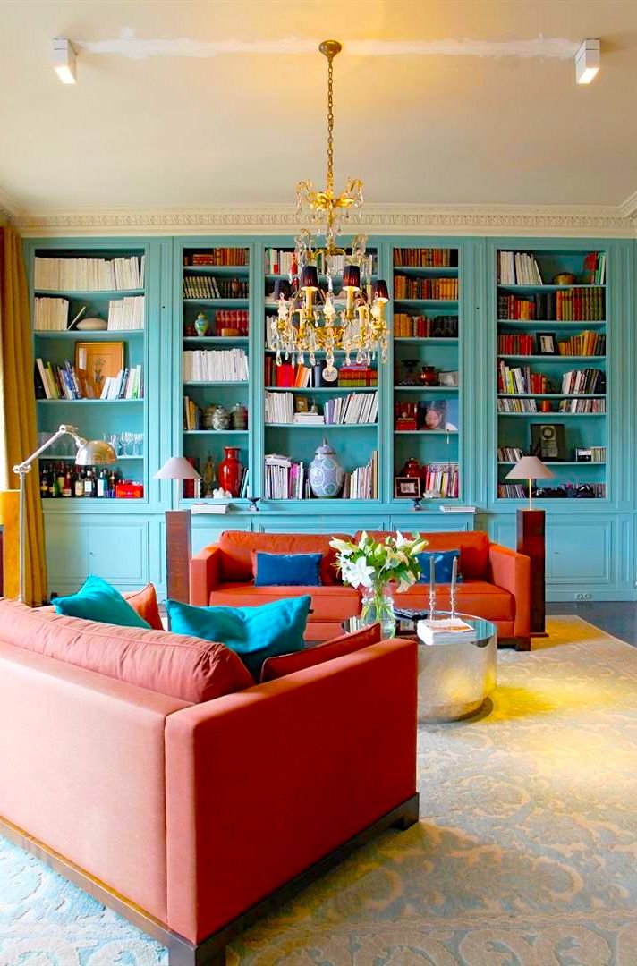 Parisian apartment home library collection with blue