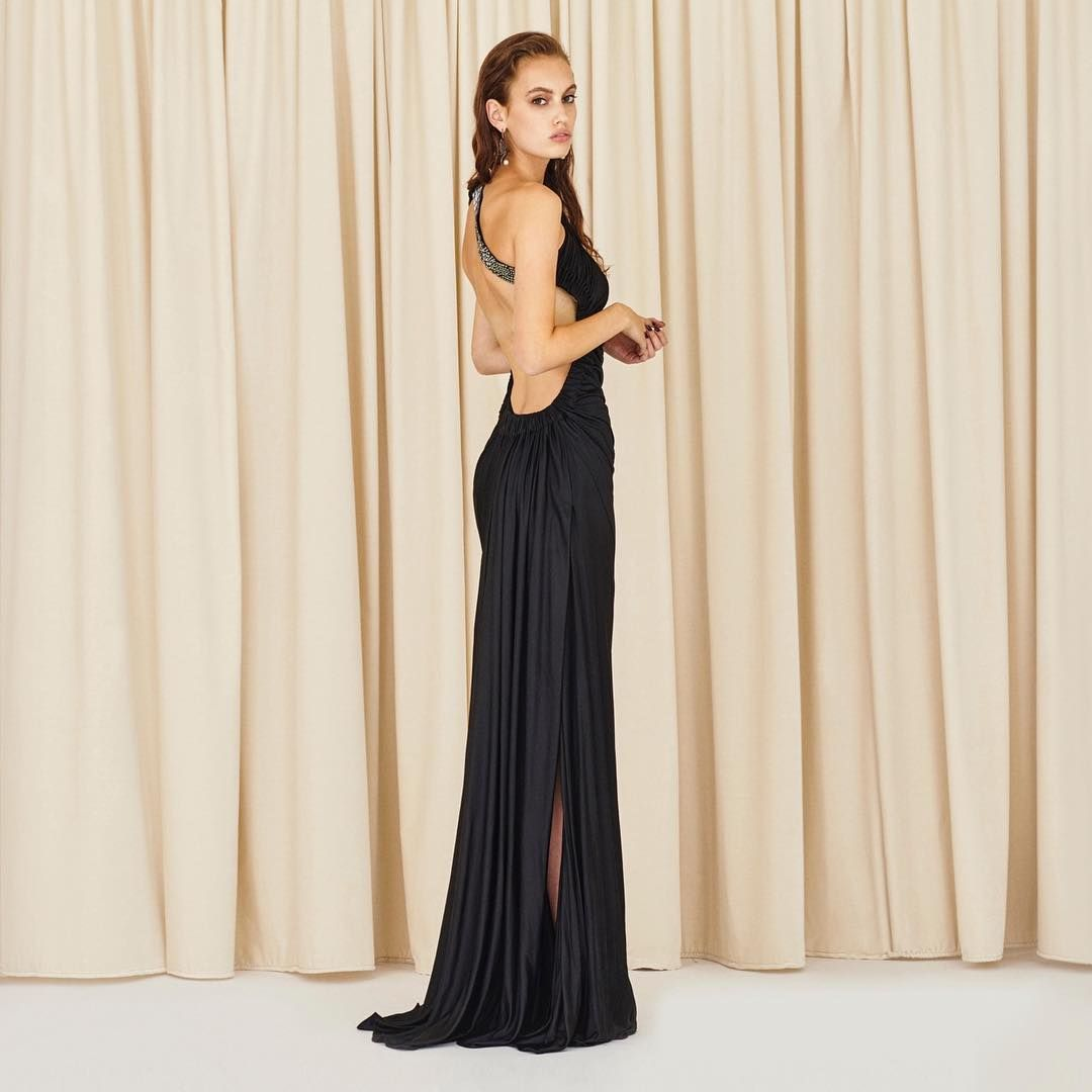 5828dcf3cd3 Utterly feminine and seductive - This black one shoulder evening dress is  softly draped for a