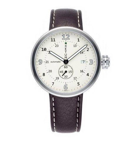 Xetum Tyndall>   Reloj con correa de piel y manecillas.  Para un creativo o tradicional, con brazos delgados para cuidar la escala/tamaño de este accesorio.