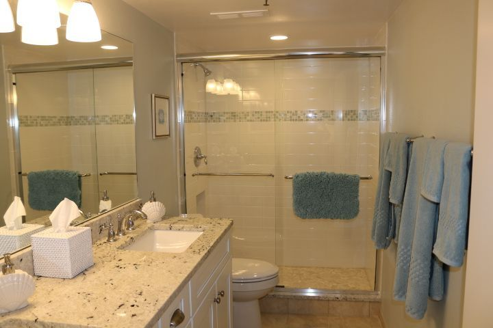 Sleek glass shower doors and beautiful countertops pull together for ...
