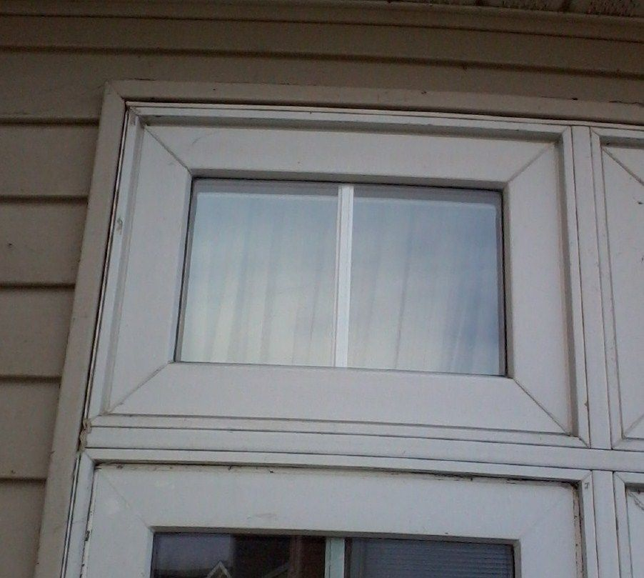 Repaired Stationary Transom Window That Was Broken Above Casement