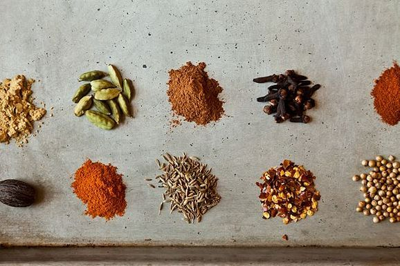 10 Essential Spices: Cumin, Cayenne Pepper, Red Pepper Flakes, Smoked Paprika, Coriander, Cloves, Cinammon, Nutmeg, Ginger, Cardamom