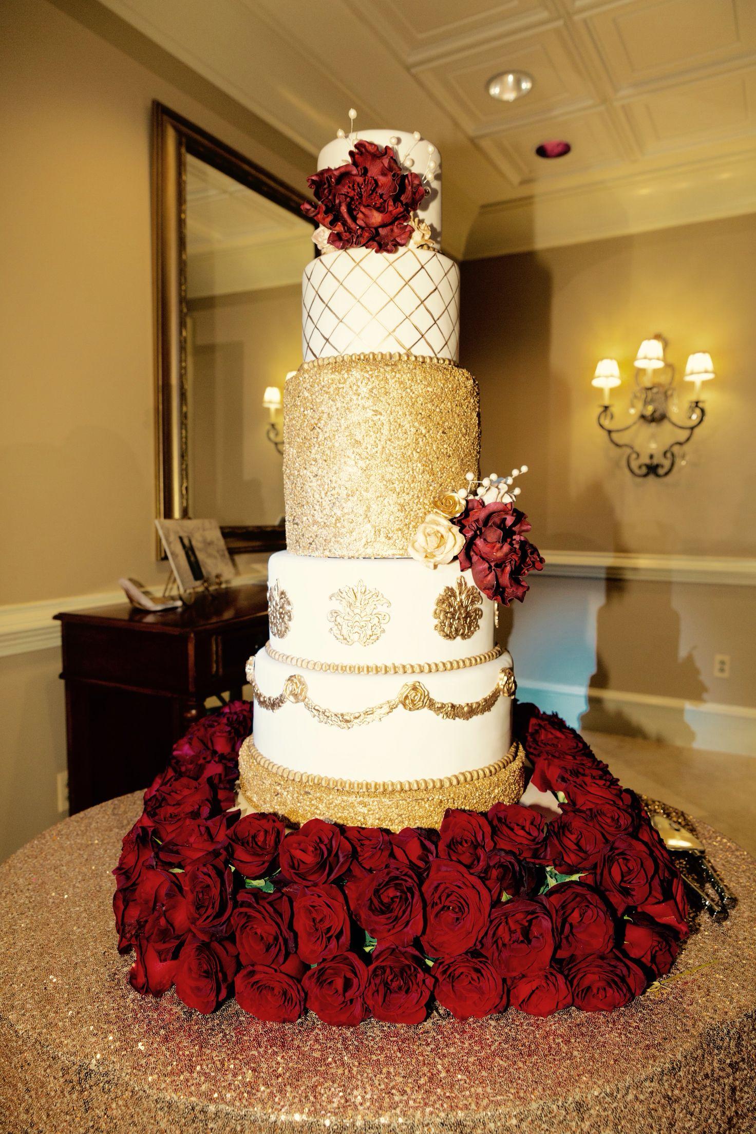 An amazing 5-tier gold and burgundy fondant wedding cake ...