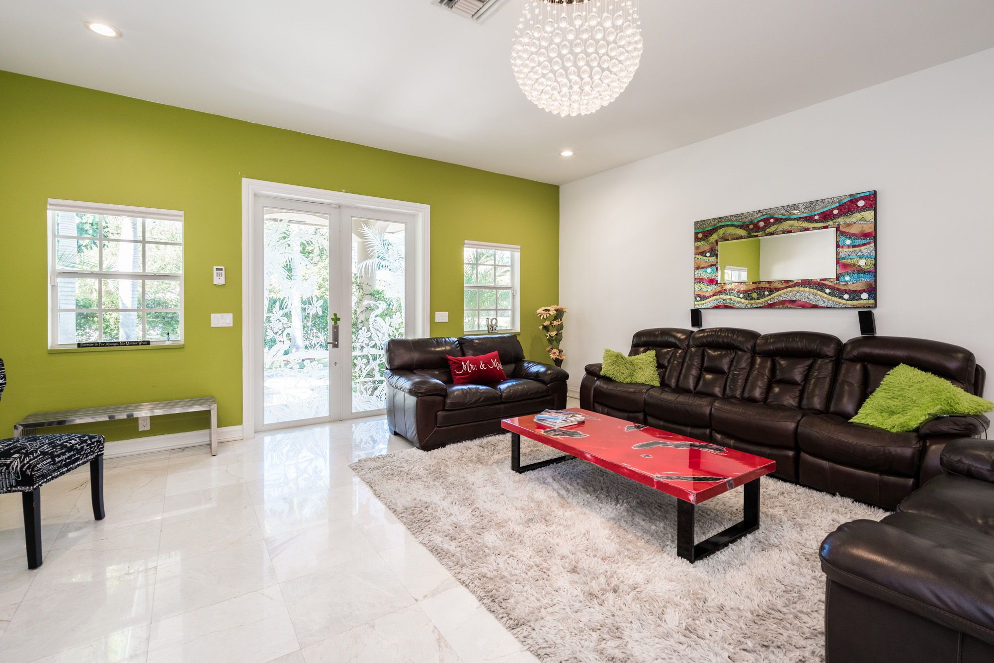 The Living Room Has Volume Ceilings Marble Flooring Glass Paned