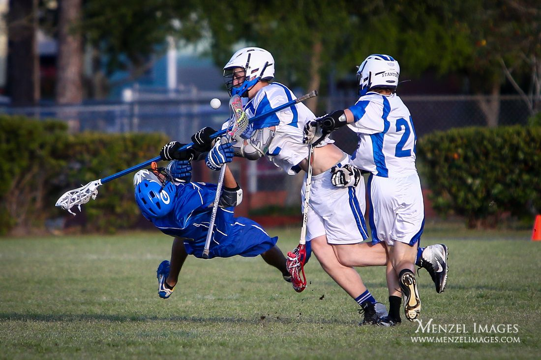 Lacrosse attack player laid out by defender. LAX. Sports